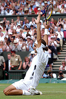Roger Federer (Switzerland) celebrates winning the Mens Singles Final against Mark Philippoussis (Australia) Wimbledon Tennis Championship, Day 13, 6/07/2003. Credit: Colorsport / Matthew Impey DIGITAL FILE ONLY