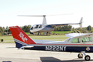 Montgomery, New York -  A Robinson R44 Raven helicopter takes off behind a Civil Air Patrol Cessna airplane at Orange County Airport on Oct. 2, 2010.