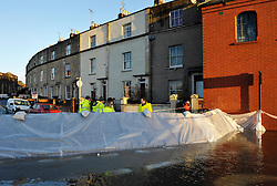© Licensed to London News Pictures. 01/02/2014; Bristol, UK.  A portable flood barrier set up in Avon Crescent near Bristol docks, protects a row of houses from spring tide flooding from the river Avon.  01 February 2014.<br /> Photo credit: Simon Chapman/LNP