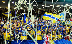 Supporters of Cimos Koper celebrate after the 1st Leg handball match between RK Cimos Koper and BM Atletico Madrid (ESP) in Quarterfinals of EHF Champions League 2011/2012, on April 21, 2012 in Arena Bonifika, Koper, Slovenia.  Cimos Koper defeated Atletico Madrid 26-23. (Photo by Vid Ponikvar / Sportida.com)