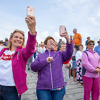 Aine O'Dea and Beatrice O'Riordan from Quilty take a photo of the swimmers leaving the Annual Pat Conway and friends Charity Swim from Lahinch to Liscannor Pier in aid of the Burren Chernobyl Project