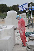 Sculpturing in Stone. Artist forming a large limestone Photographed in Maalot, Israel