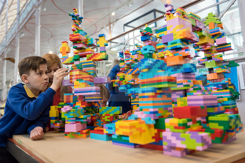 © Licensed to London News Pictures. 19/03/2018. LONDON, UK. Child 'builders', aged 8 to 10, from the local Globe Primary school, help to make a LEGO sculpture with the help of LEGO master builders at the V&A Museum of Childhood in East London.  The sculpture will be a focal point of the upcoming 'Century of the Child: Nordic Design for Children 1900 to Today' exhibition, which opens to the public on 30 March.  The free, child-friendly exhibition will also feature works by 'Nordic Icons' including Arne Jacobsen, IKEA, Alvar Aalto, Tetra Pak and Helly Hansen.  Photo credit: Stephen Chung/LNP