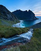 View of river flowing towards Kvalvika beach, Moskenesøy, Lofoten Islands, Norway