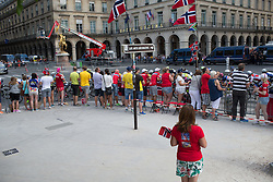 The peloton rides past the Norwegian Corner during the La Course, a 89 km road race in Paris on July 24, 2016 in France.