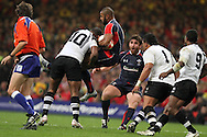 Seremaia Bai of Fiji (10) tackles Aled Brew of Wales. Invesco Perpetual series, Wales v Fiji , rugby international match at the Millennium Stadium in Cardiff on Friday 19th Nov 2010.  pic by Andrew Orchard, Andrew Orchard sports photography,