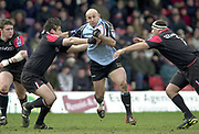 Watford, GREAT BRITAIN, 22nd Feburary 2004, Vicarage Road, ENGLAND. [Mandatory Credit: Photo  Peter Spurrier/Intersport Images],<br /> 22/02/2004  -  Zurich Premiership, Saracens v Newcastle Falcons<br /> Mark Mayerhofler goes for the gap, Taine Randell [left] and Emiliano Bergamaschi.