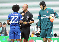Football - 2017 Community Shield - Chelsea vs. Arsenal<br /> <br /> Referee Bobby Madley books Chelsea's Willian for diving as Petr Cech looks on at Wembley.<br /> <br /> COLORSPORT/ANDREW COWIE