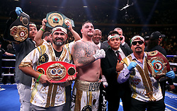 Andy Ruiz Jr (centre) celebrates the win in the WBA, IBF, WBO and IBO Heavyweight World Championships title fight against Anthony Joshua at Madison Square Garden, New York.