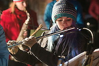 Sammy Douville performs Christmas carols with the Jackson Hole Community Band on Friday evening before the Town Square Lighting ceremony.