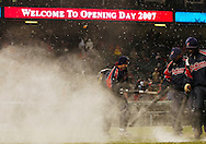 Members of the Jacobs Field ground crew blow snow from the infield grass during a weather delay in the fifth inning..Snow delayed the home opener of the Cleveland Indians/Seattle Mariners contest at Jacobs Field, April 6, 2007