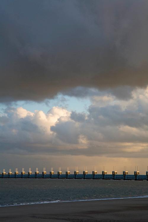 Nederland, Zeeland, Oosterschelde, 03-12-2008; Zealand, storm surge barrier in Oosterschelde (East Scheldt), between Islands of Schouwen-Duiveland and Noord-Beveland; North Sea on this side of the barrier; under normal circumstances the barrier is open to allow for the tide to enter / exit; in case of high tides in combination with storm, the slides are closed; Oosterscheldekering gezien van het strand van Noord-Beveland naar Schouwen-Duiveland, aan deze zijde van de kering de Noordzee;<br /> foto/photo  Siebe Swart