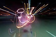 Sparklers and city lights make colorful patterns on the Fourth of July.