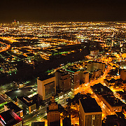 And aerial shot taken from a helicopter at about 500 feet of downtown Newark, New Jersey, at night, with the city lights showing brightly. Please note that there is some high ISO noise at full resolution.