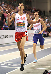 Poland's Marcin Lewandowski (left) wins gold at the Men's 1500m Final as Norway's Jakob Ingebrigtsen wins silver during day three of the European Indoor Athletics Championships at the Emirates Arena, Glasgow.