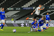Martyn Waghorn of Derby County  (9) jumps to avoid a tackle by Cardiff City defender Sean Morrison (4) during the EFL Sky Bet Championship match between Derby County and Cardiff City at the Pride Park, Derby, England on 28 October 2020.
