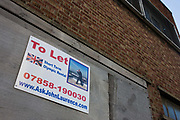 4 months before the London Olympics, a To Let sign is attached to the wall of a vacant building offering space near to the 2012 Olympic Park site. Merely a mile from the main Olympic Park site that is due to attract thousands of international interest. The 500-acre Olympic Park is the largest recreational space to open in Europe for 150 years. More than £9 billion of public money has been pumped into the area and yet some building owners with property on the periphery of the Olympic venues have left their buildings empty, hoping for last minute offers.