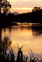 North America, United States, Oregon, Bend, canoe on Mirror Pond at sunset