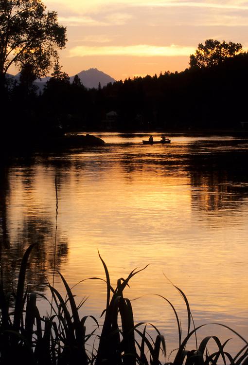 North America, United States, Oregon, Bend, canoe on Mirror Pond at sunset