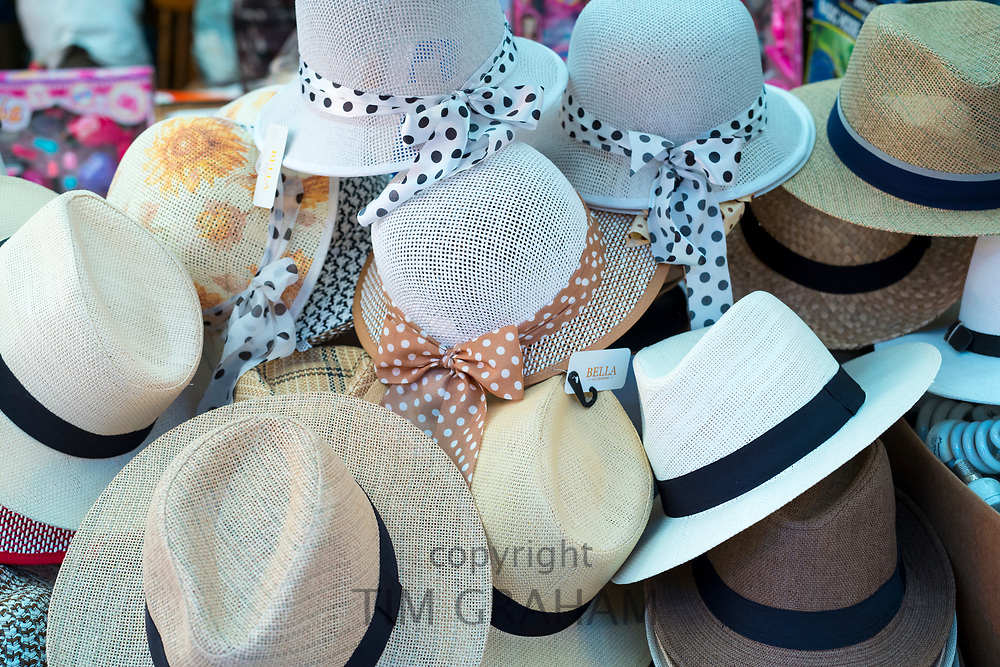 Famous Panama hat and sunhats on sale at the famous Ballero street market in Palermo, Sicily, Italy