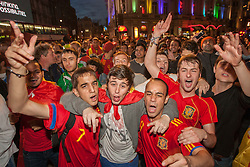 © licensed to London News Pictures. London, UK 01/07/2012. Spanish football fans celebrating in Piccadilly Circus, London as their team win the Euro 2012 final in Kiev. Photo credit: Tolga Akmen/LNP