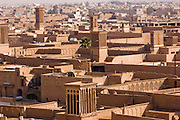 Windtowers (called badgirs in Farsi) tower over homes in the city of Yazd, Iran. They are designed to catch the wind and cool homes and other buildings naturally, with no fans or electricity. Building structures in Iran are built close together, especially in the country's hot, arid central region, and their purposefully tall earthen and brick walls create maximum shade for pedestrians in the narrow adjacent alleyways.