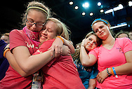 21 JULY 2013 -- SPRINGFIELD, Mo. -- Teen participants Emily Rose Alderman (left) and Catherine Burger, from Lima, Ohio, joined Grace O'Brien (third from left) and Katie Rhodes, from St. Joseph Cottleville Parish, during the call for young women considering vocations in ministry during Mass at the 2013 Steubenville St. Louis Mid-America conference on the campus of Missouri State University in Springfield, Mo. Sunday, July 21, 2013. Photo © copyright 2013 Sid Hastings.