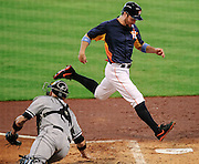 Jun 16, 2013; Houston, TX, USA; Houston Astros left fielder Trevor Crowe (8) beats the throw to Chicago White Sox catcher Tyler Flowers (21) to score from first base during the second inning at Minute Maid Park. Mandatory Credit: Thomas Campbell-USA TODAY Sports