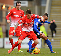 Orient's Dean Cox and Swindon's Jacob Murphy compete for the ball - Photo mandatory by-line: Mitchell Gunn/JMP - Tel: Mobile: 07966 386802 22/02/2014 - SPORT - FOOTBALL - Brisbane Road - Leyton - Leyton Orient V Swindon Town - League One