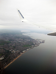 Photographs onboard an early morning Ryanair flight on it's approach over the Firth of Forth, near Edinburgh, on the way to land at Edinburgh airport, a day after the latest Iceland volcano dust scare.