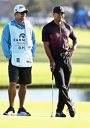 January 25, 2018 - San Diego, California, United States - Tiger Woods (R) shares a left with caddie Brett Waldman on the 18th green during the first round of the 2018 Farmers Insurance Open at Torrey Pines GC. (Credit Image: © Debby Wong via ZUMA Wire)