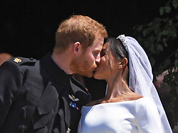 Prince Harry and Meghan Markle kiss on the steps of St George's Chapel in Windsor, UK on may 19, 2018. Photo by Neil Hall/ABACAPRESS.COM