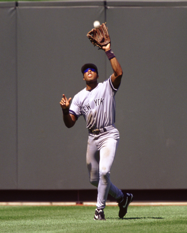 KANSAS CITY - 1995:  Bernie Williams of the New York Yankees fields during an MLB game versus the Kansas City Royals at Kaufmann Stadium in Kansas City, Missouri during the 1995 season. (Photo by Ron Vesely) Subject:   Bernie Williams