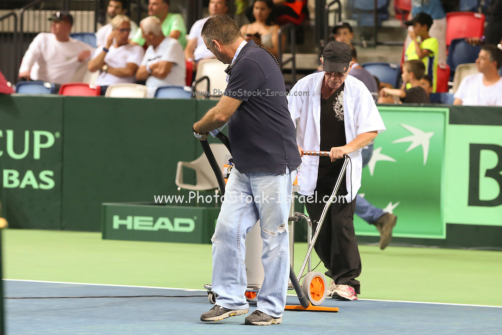 Tennis concept officials cleaning the court