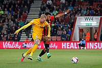 Football - 2016 / 2017 League Cup - Round 3: AFC Bournemouth vs. Preston North End<br /> <br /> Simon Makienok of Preston and Bournemouth's Tyrone Mings tussle for the ball at Dean Court (The Vitality Stadium) Bournemouth<br /> <br /> Colorsport/Shaun Boggust
