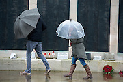 © Licensed to London News Pictures. 11/11/2014. Southsea, UK. People attend a remembrance service at the Royal Naval Memorial on Southsea Common. Wet and windy weather today, 11 November 2014, at Southsea, Portsmouth. The Met Office have issued weather warnings in some parts of the UK. Photo credit : Stephen Simpson/LNP