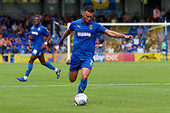 AFC Wimbledon defender Luke O'Neill (2) about to pass the ball during the EFL Sky Bet League 1 match between AFC Wimbledon and Accrington Stanley at the Cherry Red Records Stadium, Kingston, England on 17 August 2019.