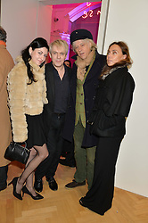 Left to right, NEFER SUVIO, NICK RHODES, SIR BOB GELDOF and JEANNE MARINE at the opening private view of 'A Strong Sweet Smell of Incense - A portrait of Robert Fraser, held at the Pace Gallery, Burlington Gardens, London on 5th February 2015.
