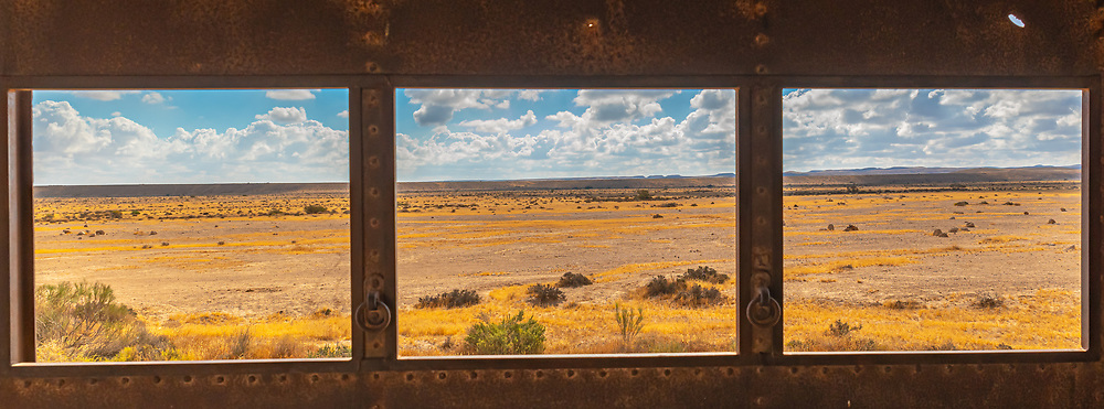 Negev Desert landscape as seen through a window in an abandoned building, Negev, Israel