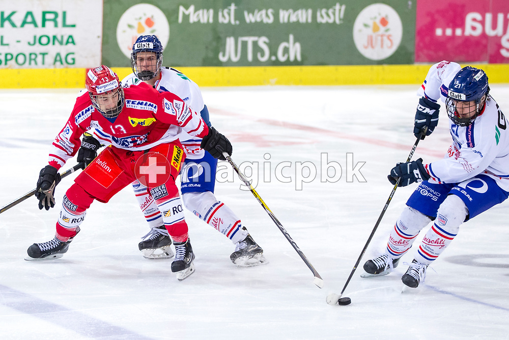 (L-R) Rapperswil-Jona Lakers forward Jonas Graetzer, EHC Buelach defenseman Tim Peter and Nicolas Bardh vie for the puck during the first Elite B 1/4 final Playoff ice hockey game between Rapperswil-Jona Lakers and EHC Buelach in Rapperswil, Switzerland, Tuesday, Feb. 13, 2018. (Photo by Patrick B. Kraemer / MAGICPBK)
