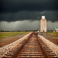 Severe storm approaching a grain elevator in southern Kansas.