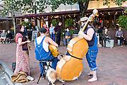 Street musicians busk in Pack Square Park in Asheville, North Carolina.