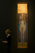 A visitor getting a preview of Nuda Veritas (1899), part of Gustav Klimt: Painting, Design and Modern Life in Vienna 1900 at the Tate Liverpool which opens on 30th May, 2008. The gallery is hosting the first-ever UK exhibition by Austrian artist Klimt (1862-1918) as part of Liverpool's reign as 2008 European Capital of Culture. The show includes a full-scale reconstruction of the The Beethoven Frieze (1901-2) in addition to numerous paintings, drawings and furniture designs and runs until 31st August, 2008.
