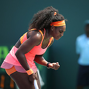 Serena Williams of the United States reacts after a bad return hit on the ball against Svetlana Kuznetsova of Russia during their match at the Miami Open tennis tournament at Crandon Park on Monday, March 30, 2015 in Key Biscayne, Florida. Williams won the match 6-2, 6-3. (AP Photo/Alex Menendez)