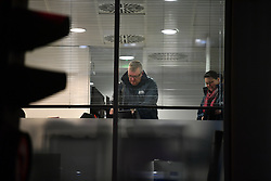 © Licensed to London News Pictures. 23/03/2018. London, UK. Workers form from the Information Commissioner's Office (ICO) are seen inside the London headquarters of data firm Cambridge Analytica. The ICO have just been granted a warrant to allow them to search the office. Cambridge Analytica has been implicated in an investigation into the misuse of Facebook user data to influence the outcome of elections. Photo credit: Ben Cawthra/LNP