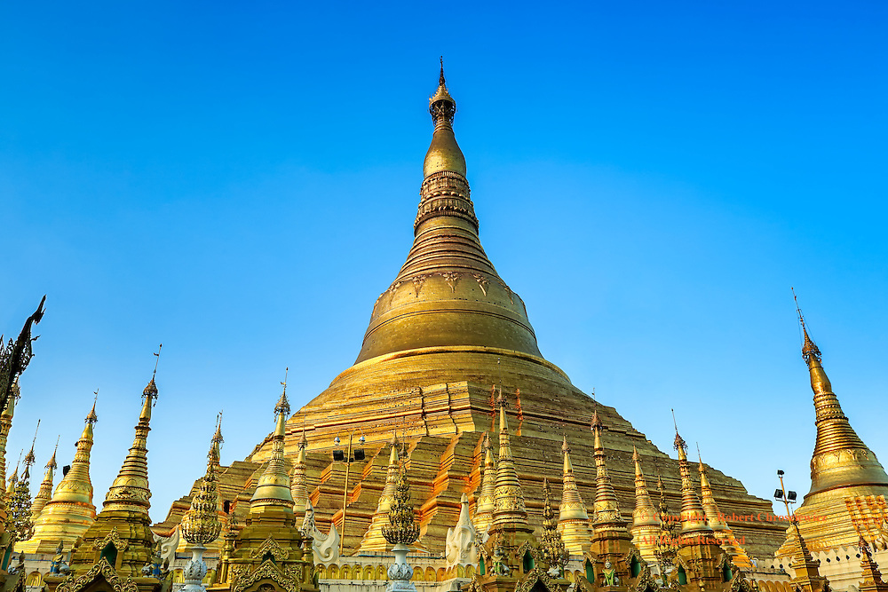 Dragon By Day:  A spectacular view of the golden Great Dragon Pagoda (Shwedagon Pagoda) seen in the late afternoons light, Yangon Myanmar.