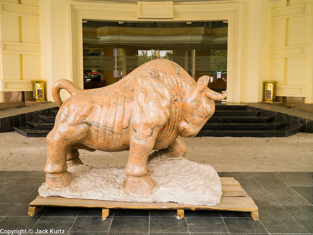 02 APRIL 2012 - HANOI, VIETNAM:  A statue of a bull, modeled after the statue of the bull on Wall Street, at the entrance to the Hanoi Stock Exchange in Hanoi, the capital of Vietnam.    PHOTO BY JACK KURTZ