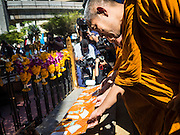 19 AUGUST 2015 - BANGKOK, THAILAND: Buddhist monks lead a service for members of a Malaysian family killed in the terror bombing of Erawan Shrine during the shrine's reopening. Erawan Shrine in Bangkok reopened Wednesday morning after more than 20 people were killed and more than 100 injured in a bombing at the shrine Monday, August 17, 2015. The shrine is a popular tourist attraction in the center of Bangkok's high end shopping district and is an important religious site for Thais. No one has claimed responsibility for the bombing.       PHOTO BY JACK KURTZ