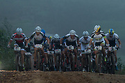 The lead bunch makes their way up a climb during stage 6 of the 2014 Absa Cape Epic Mountain Bike stage race from Oak Valley Wine Estate in Elgin, South Africa on the 29 March 2014<br /> <br /> Photo by Greg Beadle/Cape Epic/SPORTZPICS