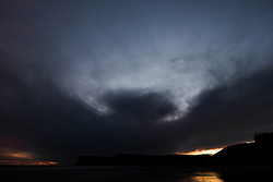© Licensed to London News Pictures.09/02/16<br /> Saltburn-by-the-Sea, UK. <br /> <br /> Dark clouds shaped like a bird rise up over cliffs at Saltburn by the Sea in North Yorkshire.<br /> <br /> Photo credit : Ian Forsyth/LNP